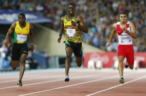 Bailey-Cole finishes first place ahead of Gemili and Livermore during the men's 100m final at the 2014 Commonwealth Games in Glasgow