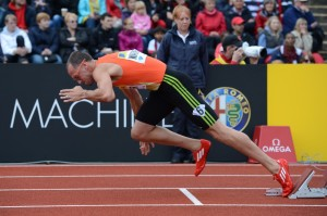 US athlete Jeremy Wariner rises from the