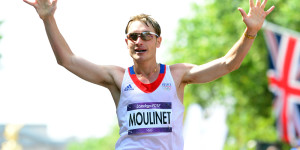 France's Bertrand Moulinet reacts as he crosses the finish line after competing in the London 2012 Olympic Games Men's 50km race walk in central London on August 11, 2012. AFP PHOTO / FRANCK FIFE